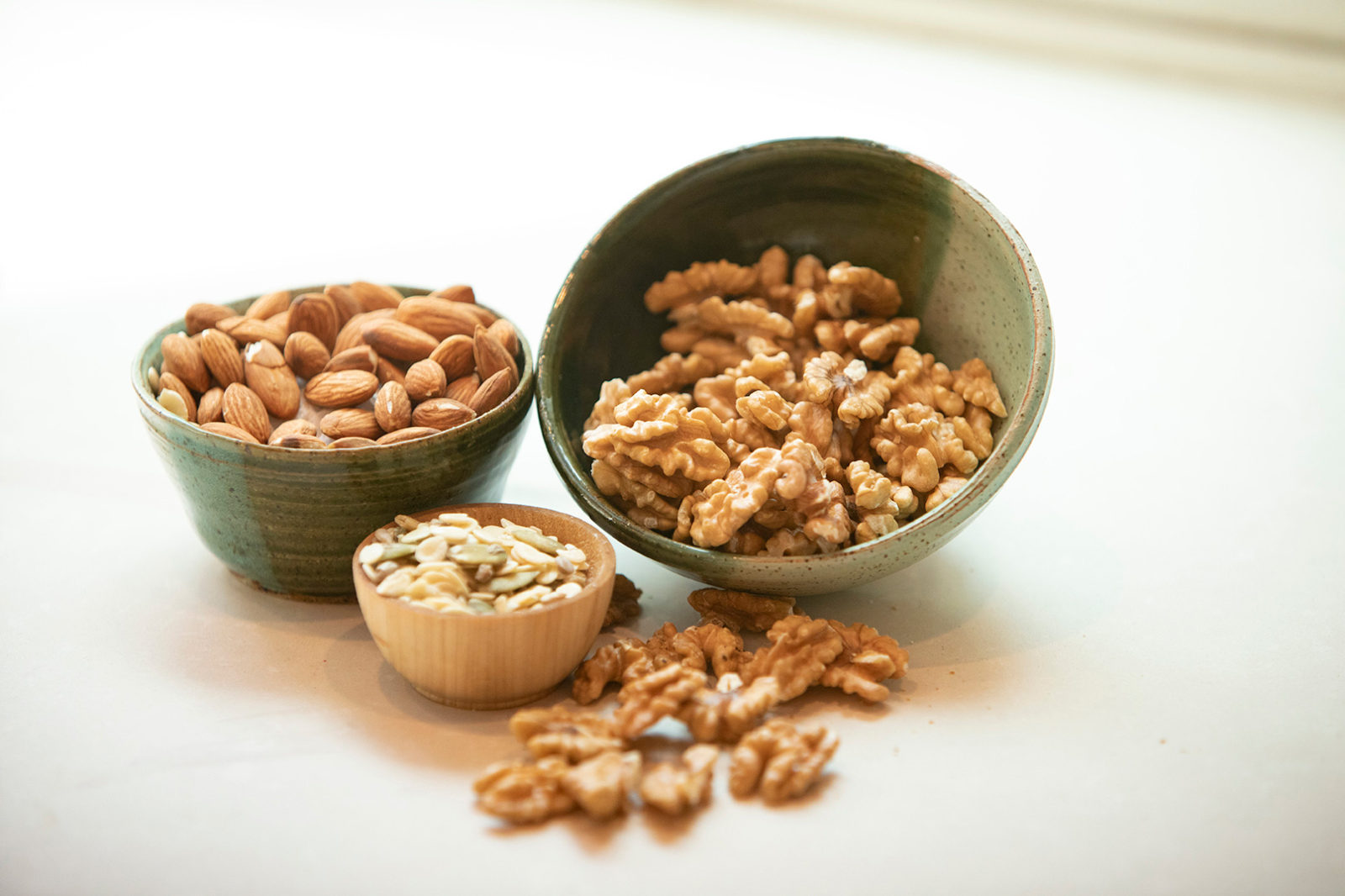 Mixed nuts and seeds in bowls